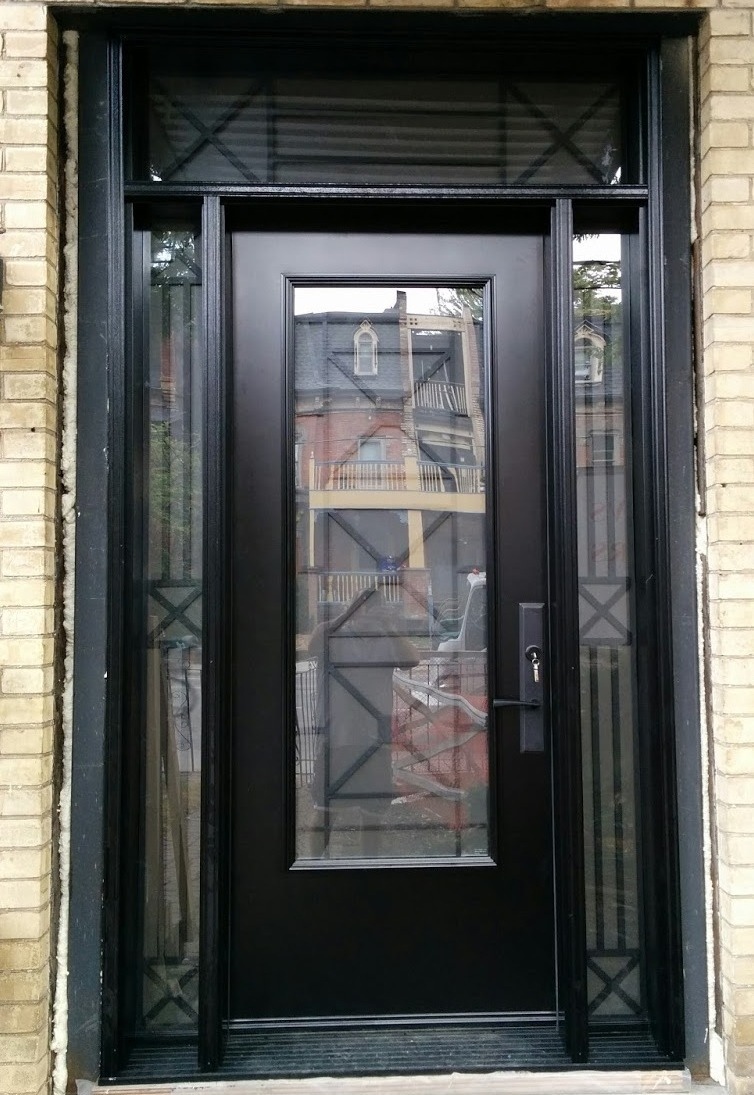 Single front entry steel insulated door. Black. 8 foot 96 inches. Matching transom and two sidelights. Century glass inserts. Multi point lock. Black threshold